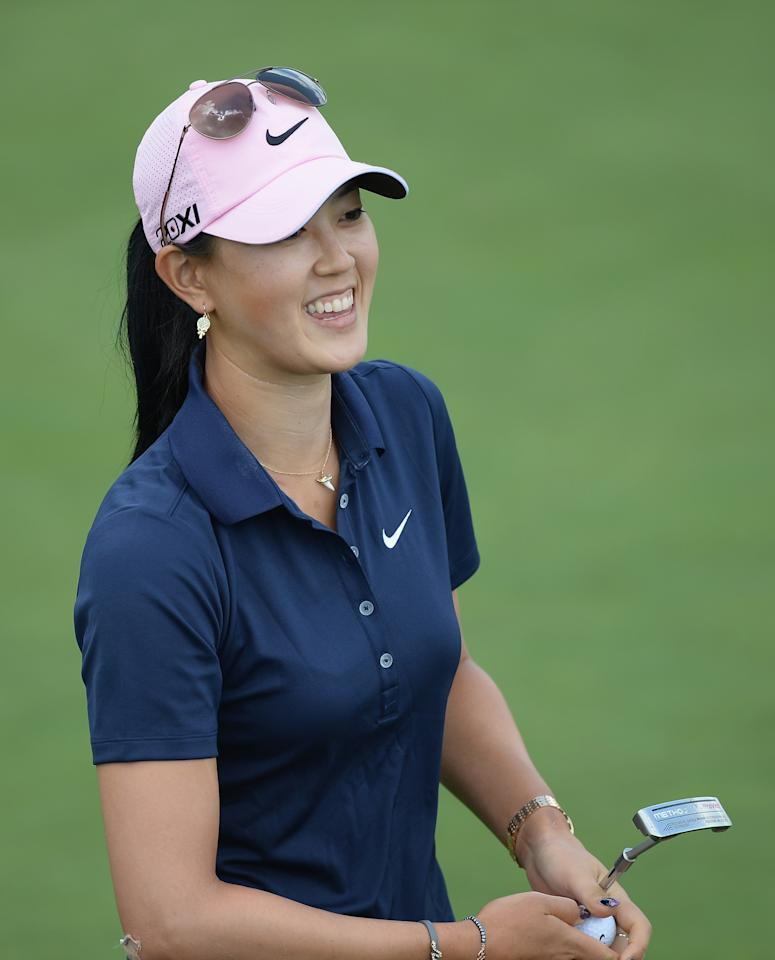 WATERLOO, CANADA - JULY 11: Michelle Wie smiles as she finishes her round on the 18th green during round one of the Manulife Financial LPGA Classic at the Grey Silo Golf Course on July 11, 2013 in Waterloo, Canada. (Photo by Harry How/Getty Images)