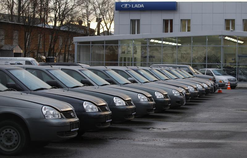 Cars are parked outside a Lada dealership in St. Petersburg