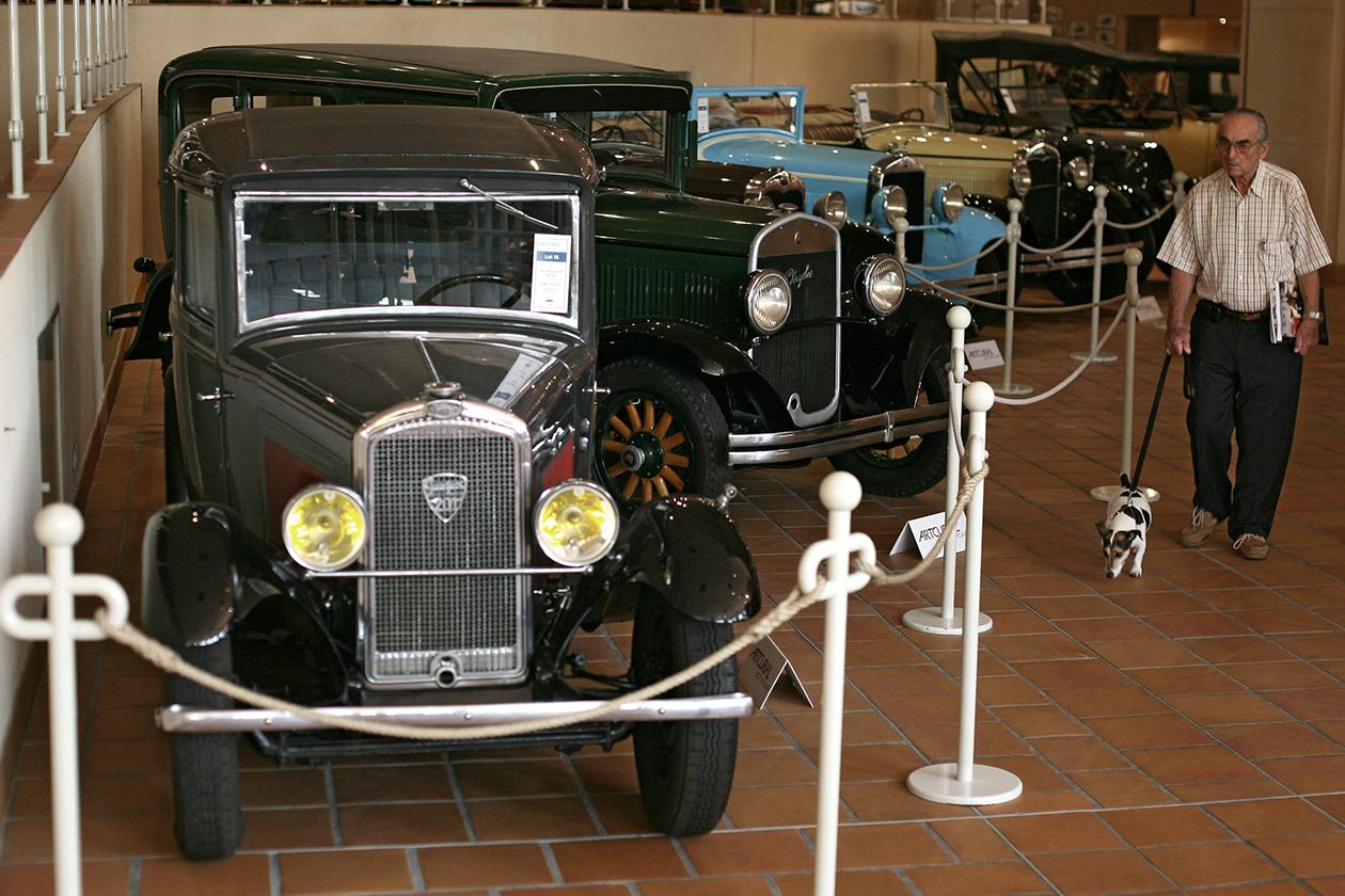 A visitor looks at the cars of the collection of Prince Albert II of Monaco.