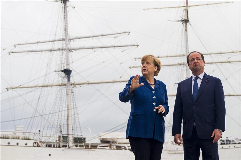 German Chancellor Merkel and French President Hollande pose for pictures in front of the tall ship Gorch Fock I, in Stralsund