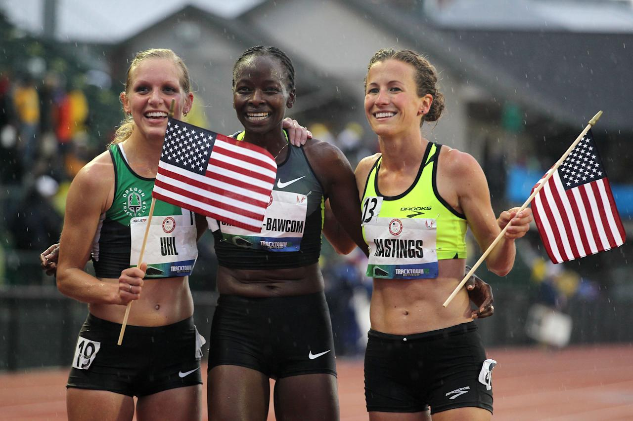 EUGENE, OR - JUNE 22:  (L-R) Lisa Uhl, Janet Cherobon-Bawcom and Amy Hastings pose after making the U.S.A Olympic team after competing in the women's 10,000 meter final during Day One of the 2012 U.S. Olympic Track & Field Team Trials at Hayward Field on June 22, 2012 in Eugene, Oregon.  (Photo by Andy Lyons/Getty Images)