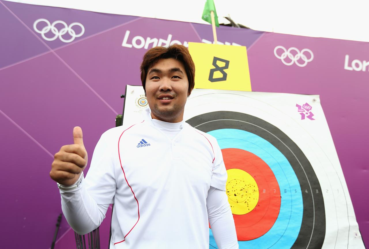 LONDON, ENGLAND - JULY 27:  Im Dong Hyun of Korea celebrates breaking the World Record during the Men's Individual Archery Ranking Round on Olympics Opening Day as part of the London 2012 Olympic Games at the Lord's Cricket Ground on July 27, 2012 in London, England.  (Photo by Paul Gilham/Getty Images)