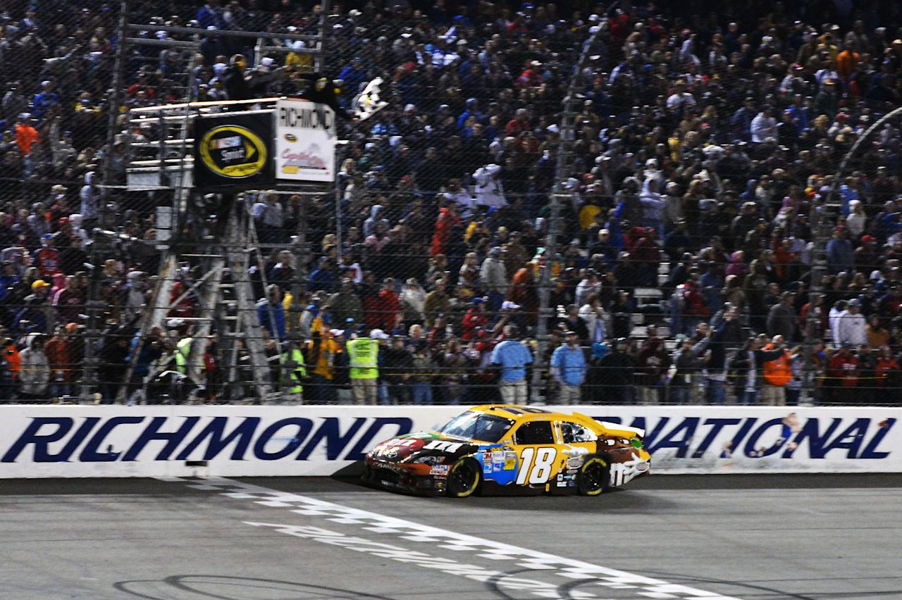 RICHMOND, VA - APRIL 28:  Kyle Busch, driver of the #18 M&M's Ms. Brown Toyota, crosses the finish line to win the NASCAR Sprint Cup Series Capital City 400 at Richmond International Raceway on April 28, 2012 in Richmond, Virginia.  (Photo by Drew Hallowell/Getty Images)