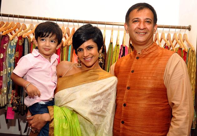 Meet little Vir - he is all of two years and looks very cute clinging on to his mom Mandira as she poses with her husband and film director Raj Kaushal.