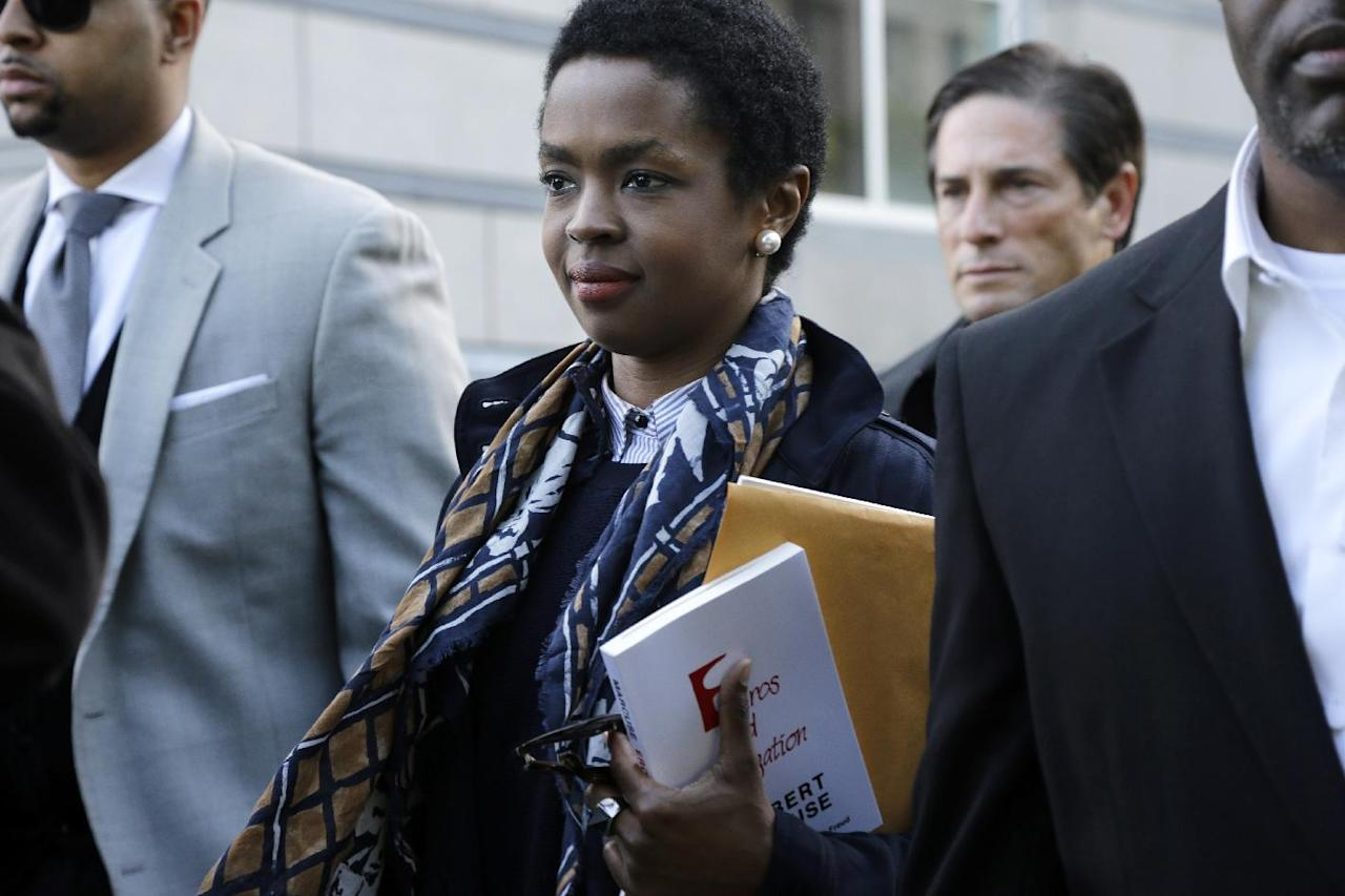 "Eight-time Grammy Award winning singer Lauryn Hill leaves federal court in Newark, N.J., Monday, May 6, 2013, after sentencing in her tax evasion case. Hill was sentenced to three months in prison and an additional three months in home confinement for failing to pay taxes on about $1 million in earnings. Hill, 37, pleaded guilty last year in the case. The South Orange resident got her start with The Fugees and began her solo career in 1998 with the acclaimed album ""The Miseducation of Lauryn Hill."" (AP Photo/Mel Evans)"