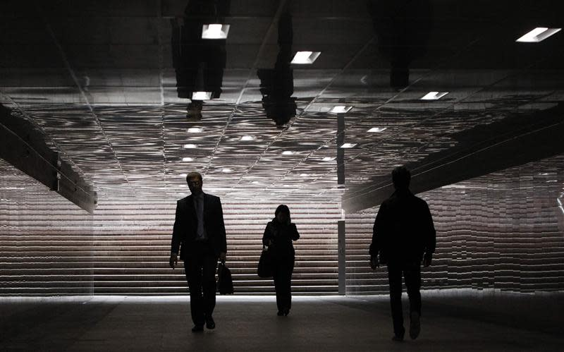 File picture shows people walking through an underground passage in Moscow