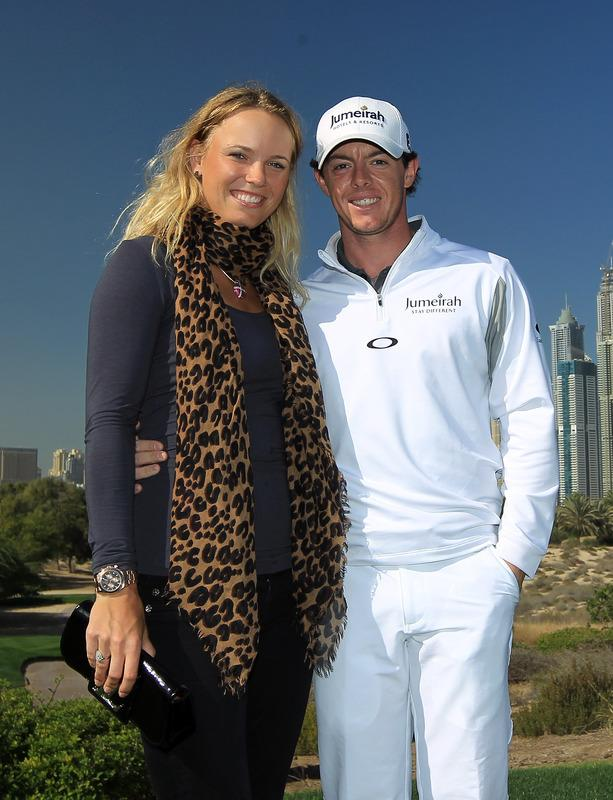 DUBAI, UNITED ARAB EMIRATES - FEBRUARY 07:  Rory McIlroy of Northern Ireland with his girlfriend Caroline Wozniacki of Denmark the World's Number One female tennis player during his practice round as a preview for the 2012 Omega Dubai Desert Classic on the Majilis Course at the Emirates Golf Club on February 7, 2012 in Dubai, United Arab Emirates.  (Photo by David Cannon/Getty Images)