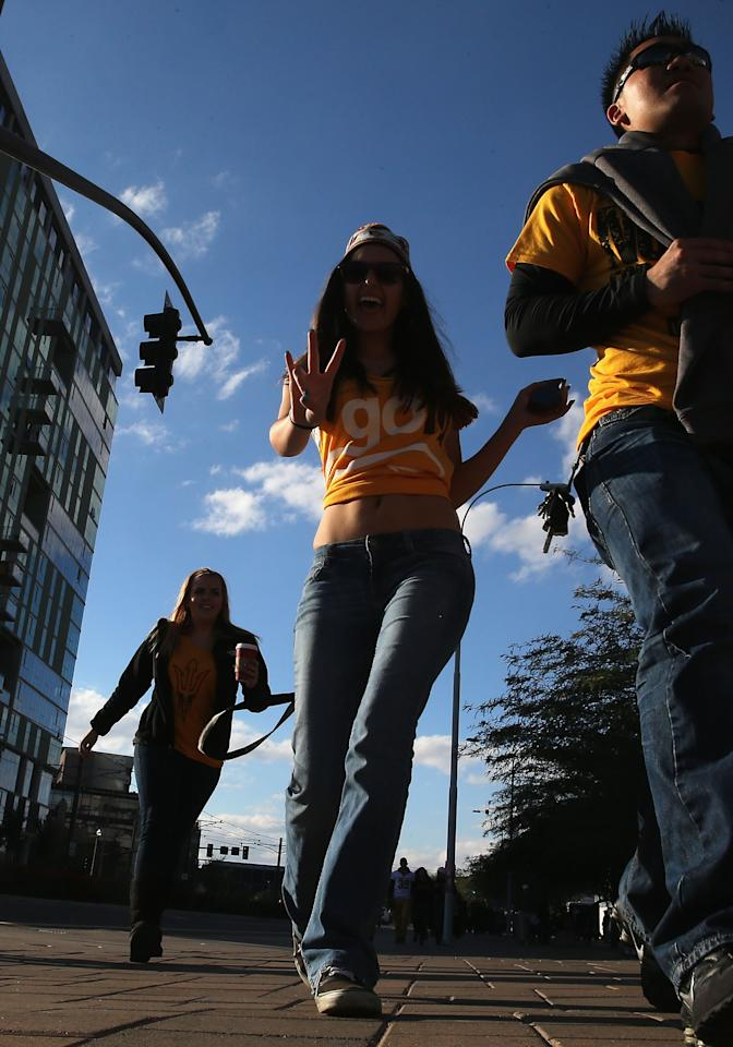 TEMPE, AZ - DECEMBER 07: Fans of the Arizona State Sun Devils react as they arrive to the Pac 12 Championship game against the Stanford Cardinal at Sun Devil Stadium on December 7, 2013 in Tempe, Arizona. (Photo by Christian Petersen/Getty Images)