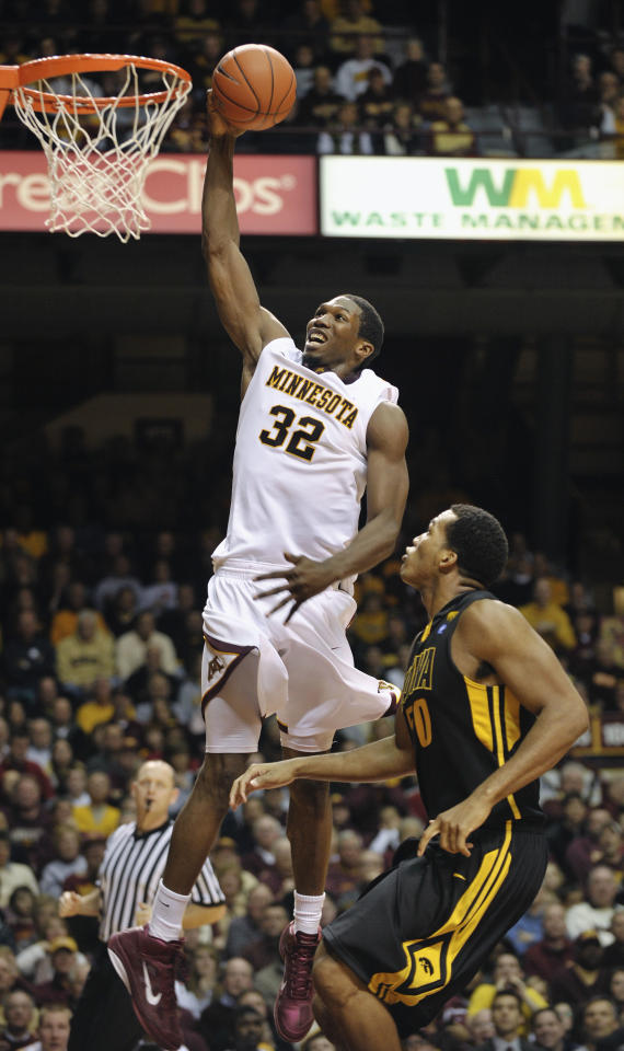 Minnesota's Trevor Mbakwe (32) goes in for a dunk over Iowa's Jarryd Cole, right, during the second half of an NCAA college basketball game Sunday, Jan. 16, 2011, in Minneapolis. Mbakwe finished with a team-high 16 points as Minnesota beat Iowa 69-59.