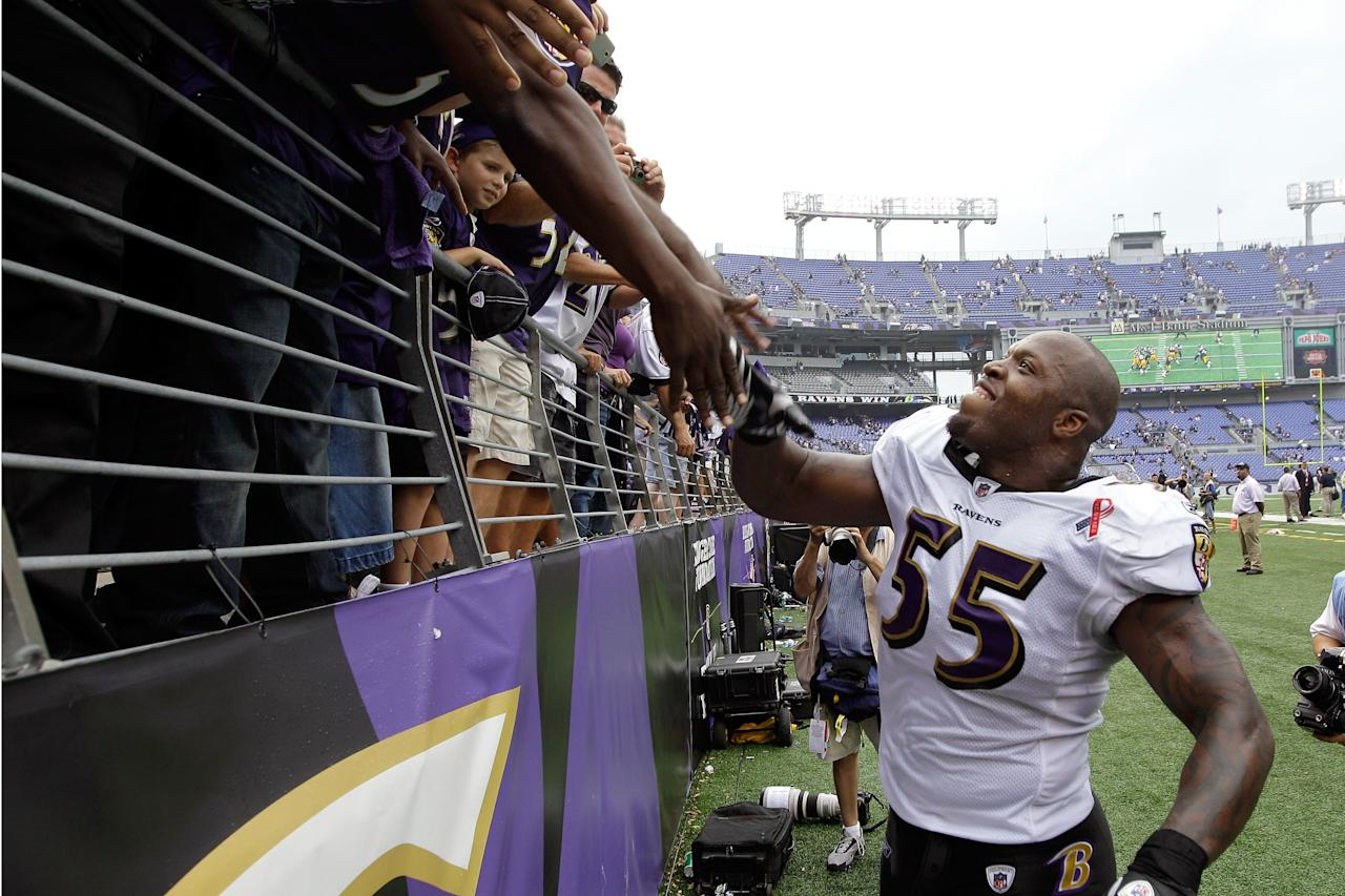 BALTIMORE, MD - SEPTEMBER 11:  Terrell Suggs #55 of the Baltimore Ravens celebrates with fans the Ravens defeated the Pittsburgh Steelers 35-7 during the season opener at M&T Bank Stadium on September 11, 2011 in Baltimore, Maryland.  (Photo by Rob Carr/Getty Images)