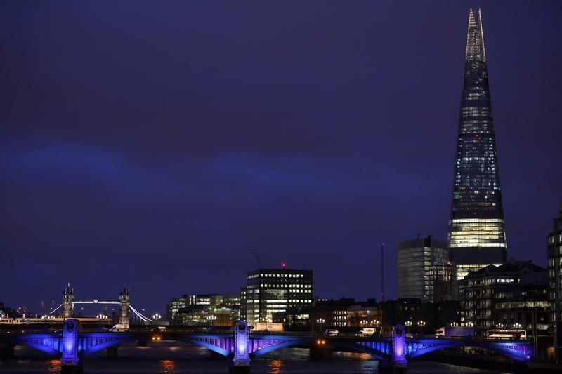 The Shard Building skyscraper is seen with Tower Bridge at dusk in London