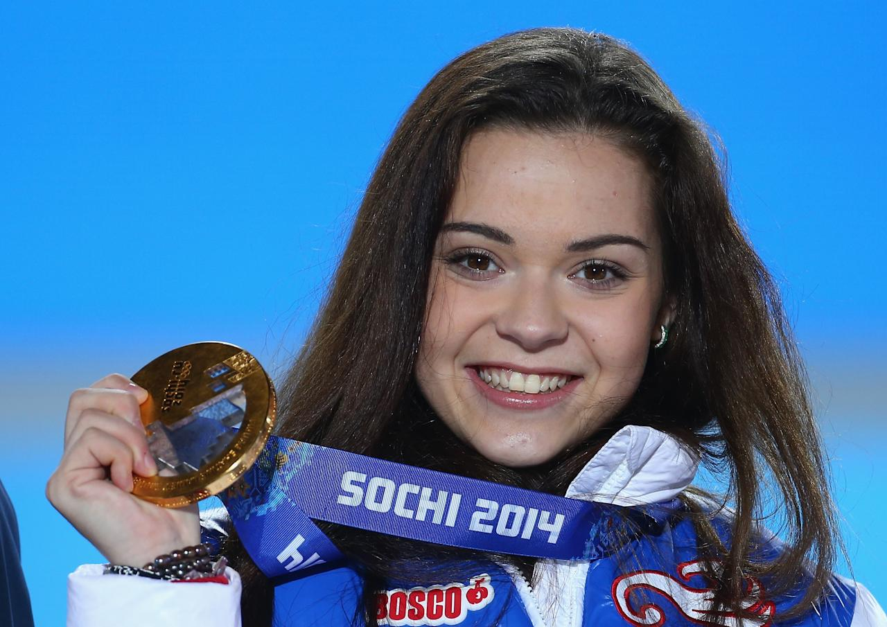 SOCHI, RUSSIA - FEBRUARY 21: Gold medalist Adelina Sotnikova of Russia celebrates during the medal ceremony for the Women's Free Figure Skating on day fourteen of the Sochi 2014 Winter Olympics at Medals Plaza on February 21, 2014 in Sochi, Russia. (Photo by Streeter Lecka/Getty Images)