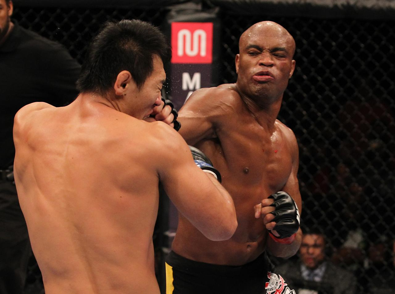 RIO DE JANEIRO, BRAZIL - AUGUST 27: (R-L) Anderson Silva punches Yushin Okami during the UFC Middleweight Championship bout at UFC 134 at HSBC Arena on August 27, 2011 in Rio de Janeiro, Brazil. (Photo by Al Bello/Zuffa LLC/[Zuffa LLC via Getty Images)