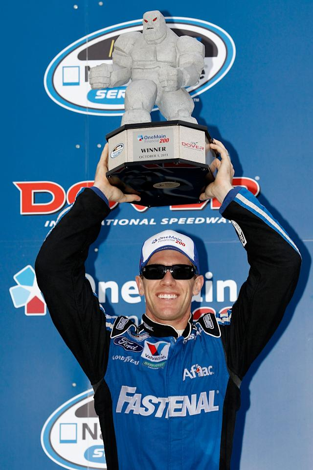 DOVER, DE - OCTOBER 01:  Carl Edwards, driver of the #60 Fastenal Ford, celebrates with the trophy in victory lane after he won the NASCAR Nationwide Series OneMain Financial 200 at Dover International Speedway on October 1, 2011 in Dover, Delaware.  (Photo by Todd Warshaw/Getty Images for NASCAR)