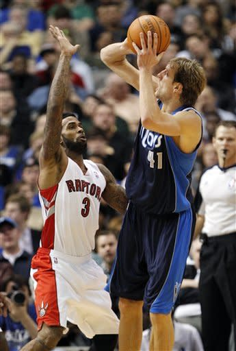 Mavs beat Raptors 99-86 for first win