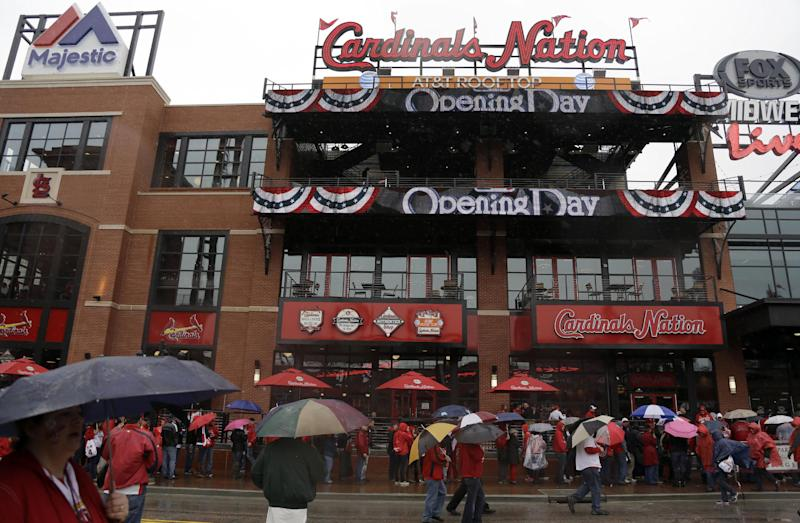 Wacha pitches Cards past Reds 5-3 in home opener