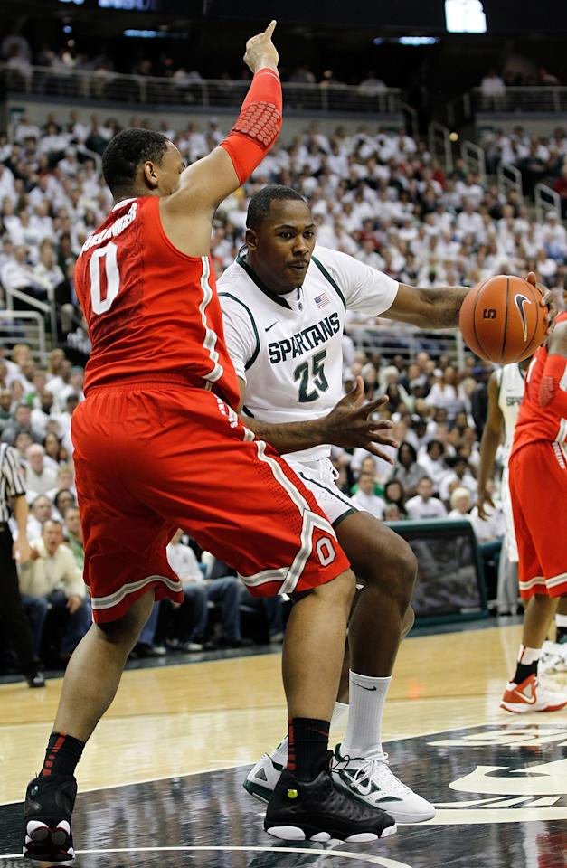 EAST LANSING, MI - MARCH 04: Derrick Nix #25 of the Michigan State Spartans drives to the basket as Jared Sullivan #0 of the Ohio State University defends during the first half of the game at Breslin Center on March 4, 2012 in East Lansing, Michigan.  (Photo by Leon Halip/Getty Images)