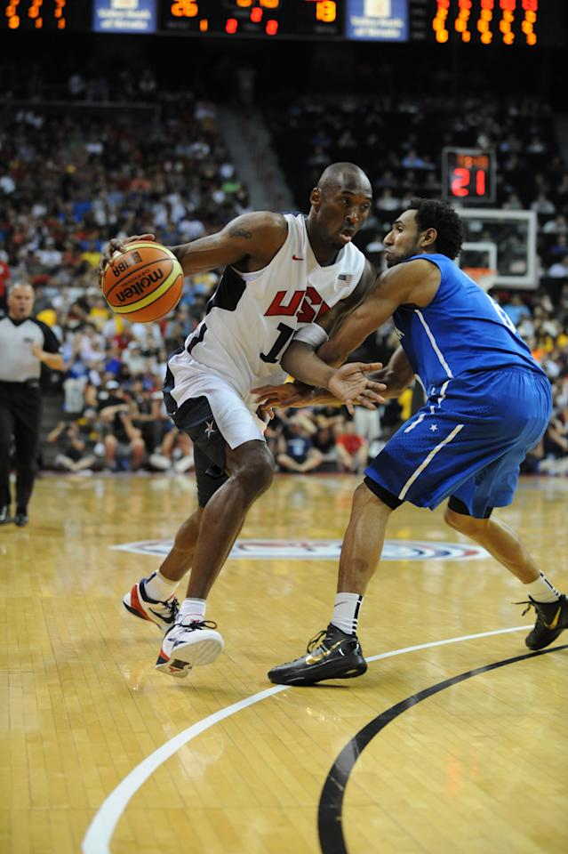 LAS VEGAS, NV - JULY 12:  Kobe Bryant #10 of the US Men's Senior National Team drives against the Dominican Republic during an exhibition game at the Thomas and Mack Center on July 12, 2012 in Las Vegas, Nevada. NOTE TO USER: User expressly acknowledges and agrees that, by downloading and/or using this Photograph, user is consenting to the terms and conditions of the Getty Images License Agreement. Mandatory Copyright Notice: Copyright 2012 NBAE (Photo by Noah Graham/NBAE via Getty Images)