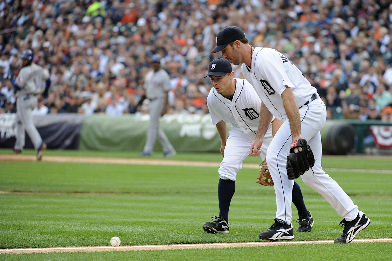 DETROIT, MI - OCTOBER 13:  Justin Verlander #35 and Brandon Inge #15 of the Detroit Tigers watch as a ball stays fair on a hit by Elvis Andrus #1 of the Texas Rangers in Game Five of the American League Championship Series at Comerica Park on October 13, 2011 in Detroit, Michigan.  (Photo by Harry How/Getty Images)