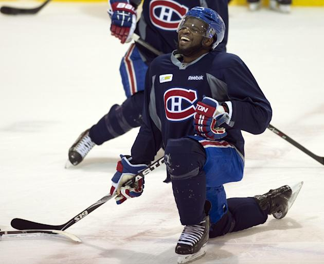 Montreal Canadiens defenseman P.K. Subban has a laugh as he stretches during NHL hockey practice Friday, May 16, 2014 in Brossard, Quebec. The Canadiens host the New York Rangers in Game one of the Eastern Conference final in the Stanley Cup playoffs on Saturday in Montreal. (AP Photo/The Canadian Press, Ryan Remiorz)