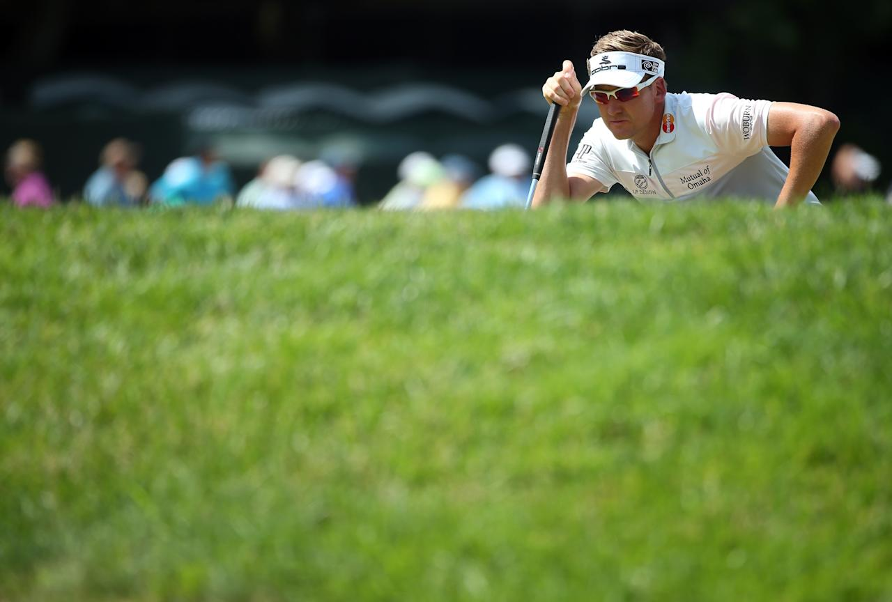 ARDMORE, PA - JUNE 15: Ian Poulter of England lines up his putt on the third hole during Round Three of the 113th U.S. Open at Merion Golf Club on June 15, 2013 in Ardmore, Pennsylvania. (Photo by Andrew Redington/Getty Images)