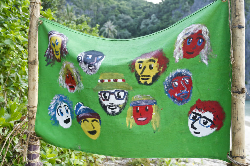 """Come Over to the Dark Side"" - Portraits of the merged tribe are painted on the back of the Enil Edam flag during the Eleventh episode of ""Survivor: Caramoan - Fans vs. Favorites."""