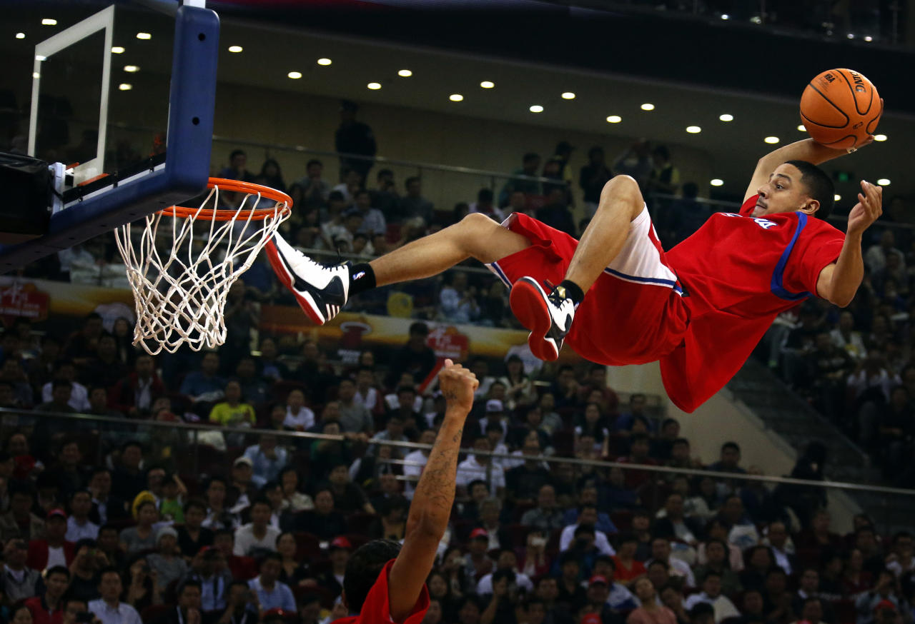 A stunt performer prepares to dunk during a break in the first of the NBA China Games between the Miami Heat and the Los Angeles Clippers at Wukesong arena in Beijing October 11, 2012. REUTERS/David Gray  (CHINA - Tags: SPORT BASKETBALL)