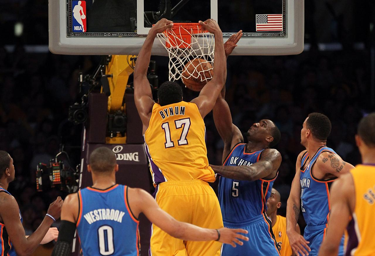 LOS ANGELES, CA - MAY 19:  Andrew Bynum #17 of the Los Angeles Lakers dunks the ball over Kendrick Perkins #5 of the Oklahoma City Thunder in the third quarter in Game Four of the Western Conference Semifinals in the 2012 NBA Playoffs on May 19 at Staples Center in Los Angeles, California. NOTE TO USER: User expressly acknowledges and agrees that, by downloading and or using this photograph, User is consenting to the terms and conditions of the Getty Images License Agreement.  (Photo by Stephen Dunn/Getty Images)