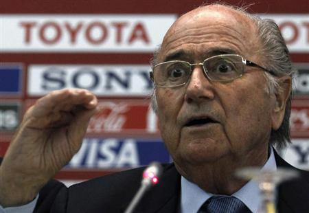 Blatter speaks during a news conference in Marrakech