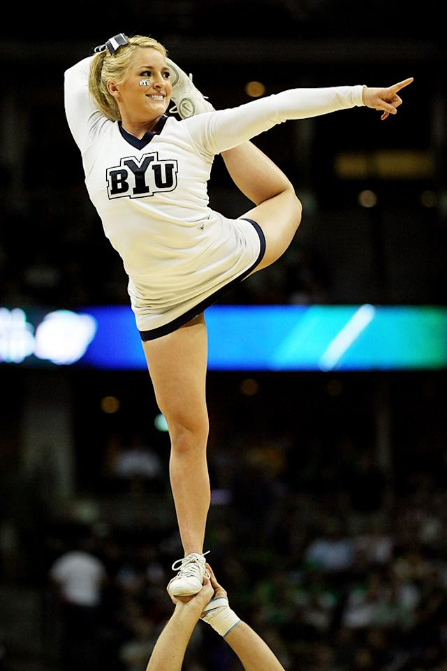 A cheerleader from the Brigham Young Cougars performs during the second round of the 2011 NCAA men's basketball tournament at Pepsi Center on March 17, 2011 in Denver, Colorado.  (Photo by Justin Edmonds/Getty Images)