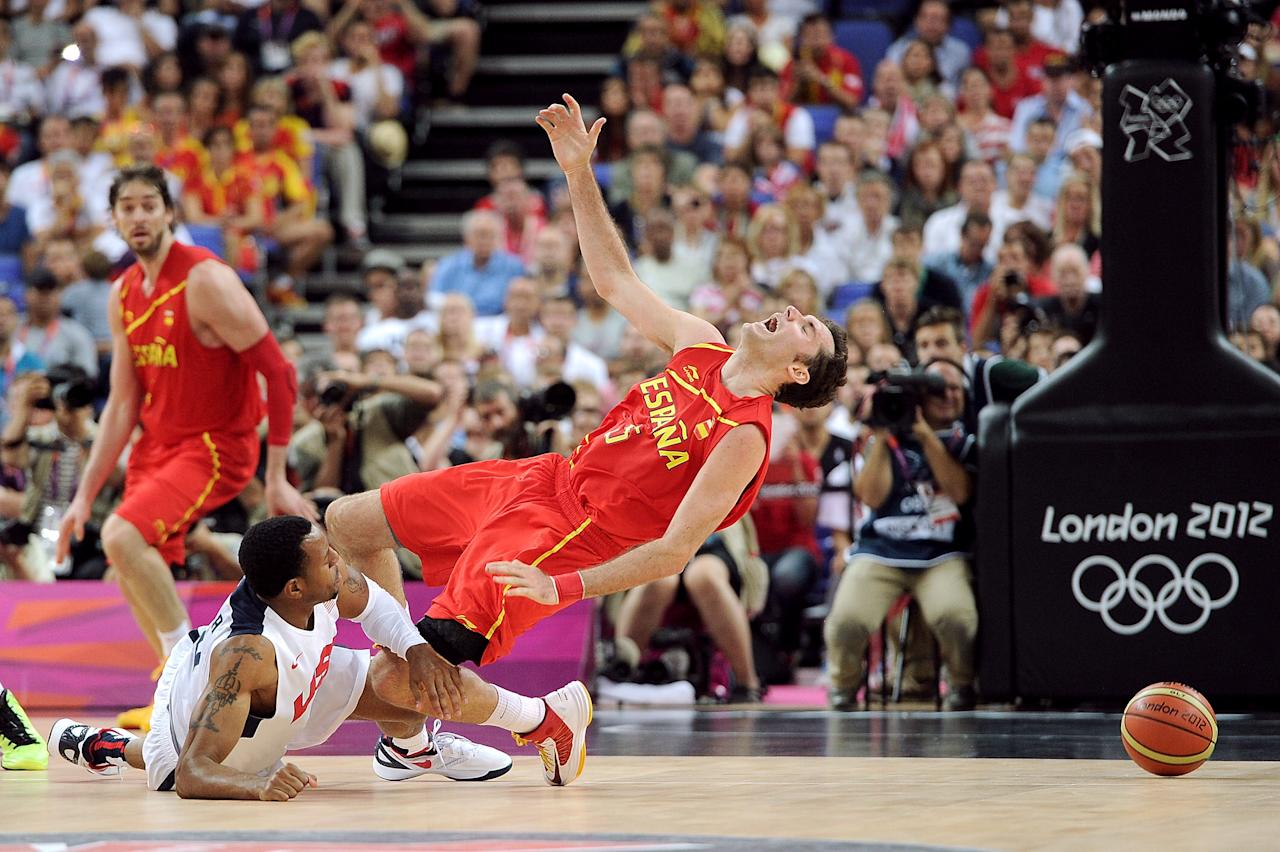 LONDON, ENGLAND - AUGUST 12: Andre Iguodala #9 of the United States fouls Rudy Fernandez #5 of Spain during the Men's Basketball gold medal game between the United States and Spain on Day 16 of the London 2012 Olympics Games at North Greenwich Arena on August 12, 2012 in London, England.  (Photo by Harry How/Getty Images)