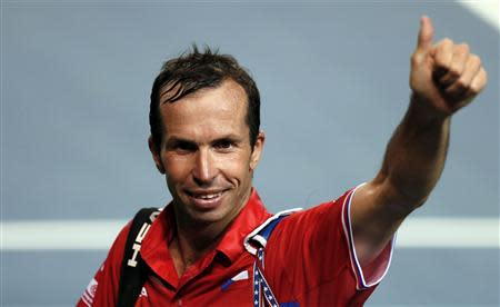 Stepanek of the Czech Republic gestures to the crowd as he leaves the court after winning his Davis Cup quarter-final tennis match against Japan's Ito in Tokyo