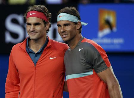 Roger Federer of Switzerland poses for a photo with Rafael Nadal of Spain before their men's singles semi-final match at the Australian Open 2014 tennis tournament in Melbourne
