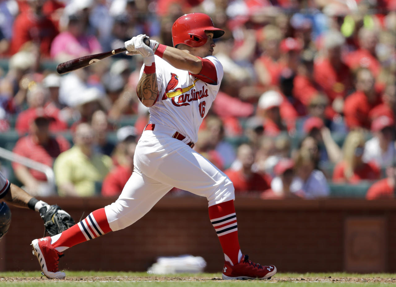 St. Louis Cardinals' Kolten Wong watches his three-run double during the second inning of a baseball game against the Atlanta Braves Sunday, May 18, 2014, in St. Louis. (AP Photo/Jeff Roberson)