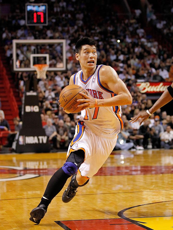 MIAMI, FL - FEBRUARY 23: Jeremy Lin #17 of the New York Knicks drives during a game against the Miami Heat at American Airlines Arena on February 23, 2012 in Miami, Florida. NOTE TO USER: User expressly acknowledges and agrees that, by downloading and/or using this Photograph, User is consenting to the terms and conditions of the Getty Images License Agreement.  (Photo by Mike Ehrmann/Getty Images)