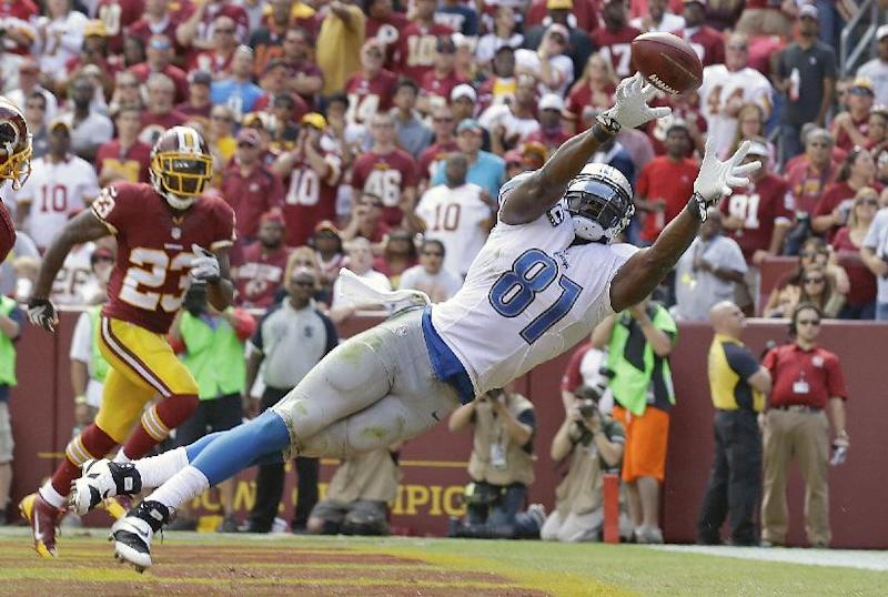 Detroit Lions tight end Brandon Pettigrew can't quite reach a Matthew Stafford pass in the end zone as Washington Redskins cornerback DeAngelo Hall watches in the background during the first half of a NFL football game in Landover, Md., Sunday, Sept. 22, 2013