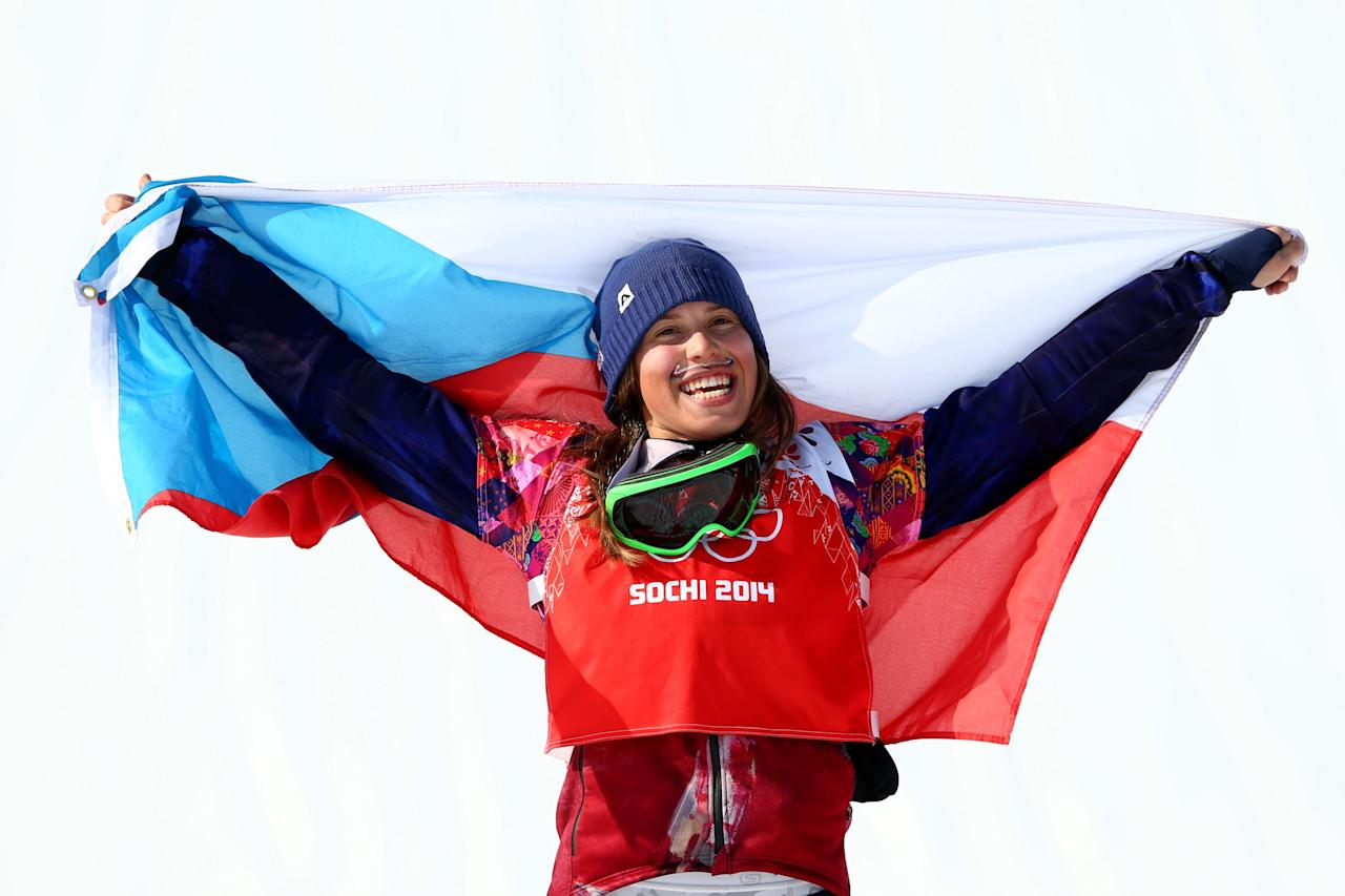 SOCHI, RUSSIA - FEBRUARY 16: Gold medalist Eva Samkova of the Czech Republic celebrates during the flower ceremony for the Ladies' Snowboard Cross Finals on day nine of the Sochi 2014 Winter Olympics at Rosa Khutor Extreme Park on February 16, 2014 in Sochi, Russia. (Photo by Cameron Spencer/Getty Images)