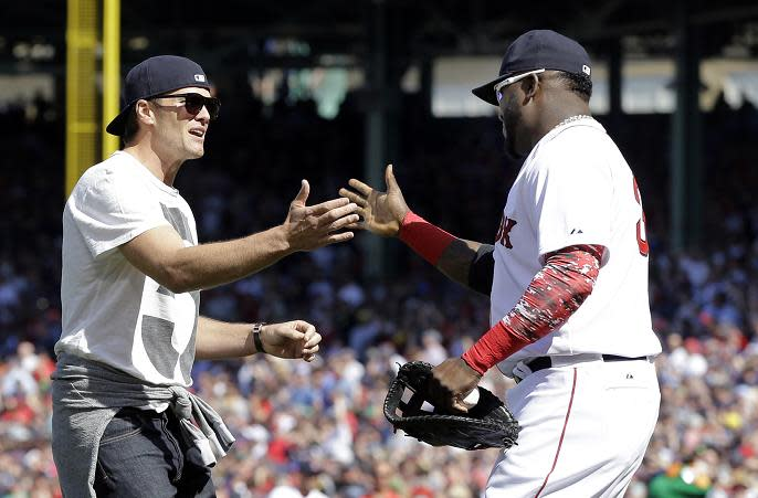Tom Brady greets David Ortiz after throwing the ceremonial first pitch prior to the Red Sox home opener in 2015. (AP)