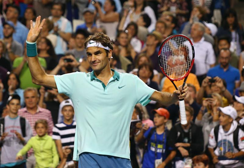 Roger Federer of Switzerland celebrates his semi-final win over Feliciano Lopez of Spain during Rogers Cup, at Rexall Centre in Toronto, Canada, on August 9, 2014