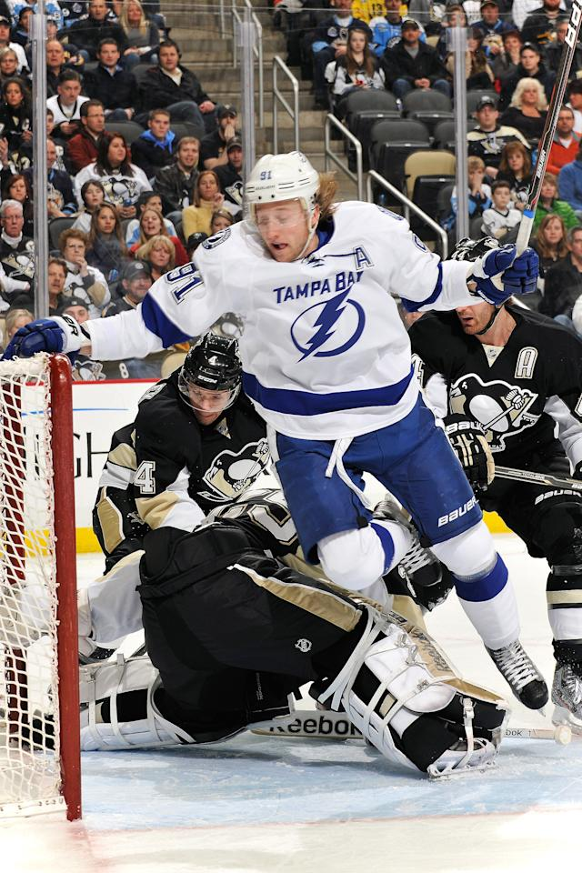 PITTSBURGH, PA - FEBRUARY 25:  Steven Stamkos #91 of the Tampa Bay Lightning leaps over goaltender Marc-Andre Fleury #29 of the Pittsburgh Penguins to avoid a collision in the first period on February 25, 2012 at CONSOL Energy Center in Pittsburgh, Pennsylvania.  (Photo by Jamie Sabau/Getty Images)