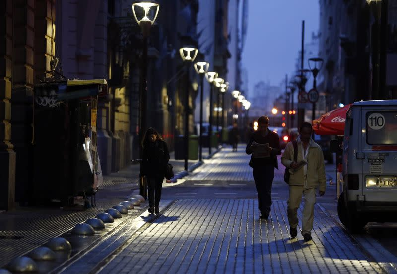 People walk in Buenos Aires' financial district