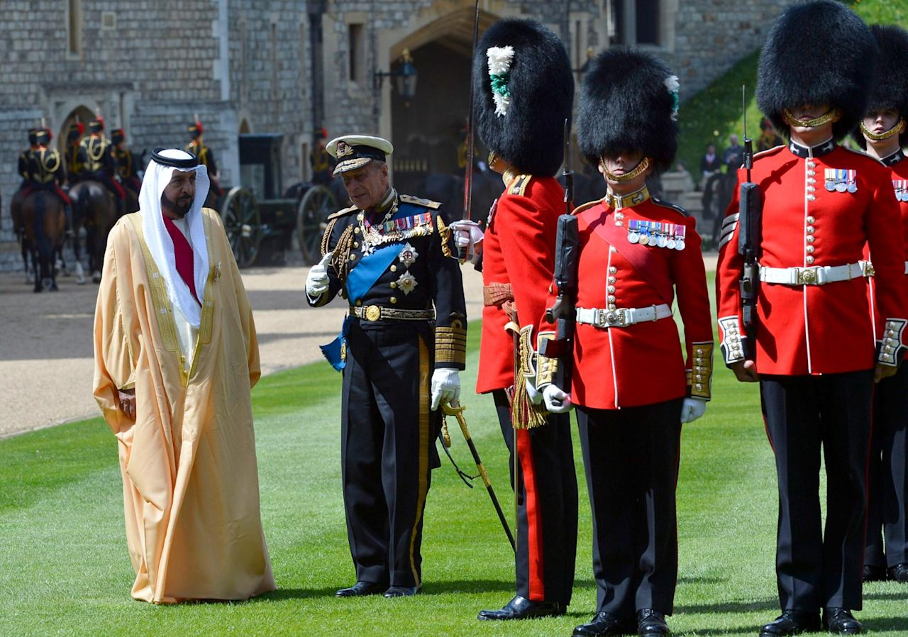 WINDSOR, ENGLAND - APRIL 30:  Prince Philip, the Duke of Edinburgh speaks with President of the United Arab Emirates, His Highness Sheikh Khalifa bin Zayed Al Nahyan as they prepare to review an honour guard during a ceremonial welcome on April 30, 2013 in Windsor, England. President Sheikh Khalifa begins a State visit to the UK today, the first for a UEA President in 24 years. Sheikh Khalifa will meet the British Prime Minister David Cameron tomorrow at his Downing Street residence.  (Photo by Toby Melville - WPA Pool/Getty Images)