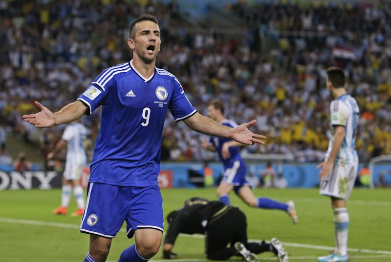 Bosnia's Vedad Ibisevic (9) celebrates after scoring his side's first goal during the group F World Cup soccer match between Argentina and Bosnia at the Maracana Stadium in Rio de Janeiro, Brazil, Sunday, June 15, 2014