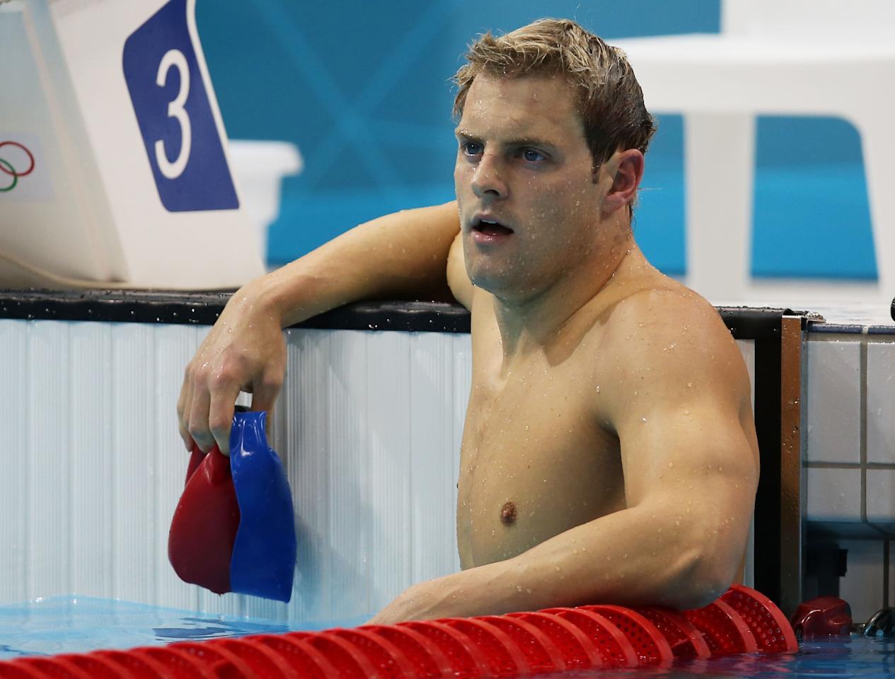 LONDON, ENGLAND - JULY 30:  Liam Tancock of Great Britain looks on after he competed in the Final of the Men's 100m Backstroke on Day 3 of the London 2012 Olympic Games at the Aquatics Centre on July 30, 2012 in London, England.  (Photo by Clive Rose/Getty Images)