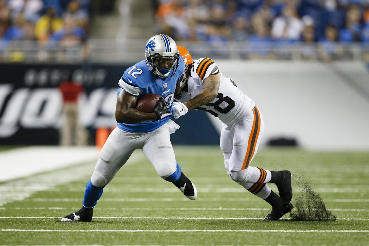 Detroit Lions wide receiver Jeremy Ross (12) breaks free from Cleveland Browns defensive back Aaron Berry (38) in the first half of a preseason NFL football game at Ford Field in Detroit, Saturday, Aug. 9, 2014. (AP Photo/Rick Osentoski)