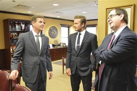 Florida's Senate President-designate Andy Gardiner, Republican of Orlando, talks with former England soccer player David Beckham during a visit to the state legislature in Tallahassee