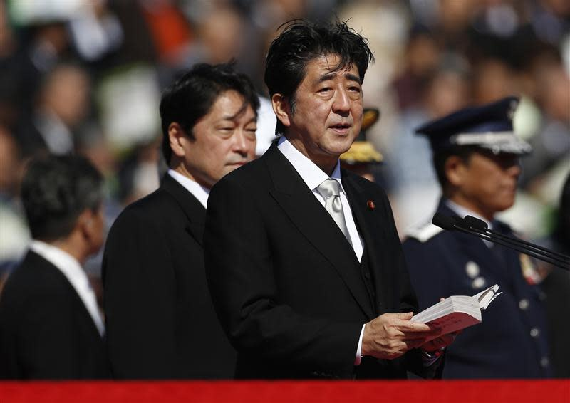 Japanese PM Abe delivers a speech as he reviews Japan SDF troops during the annual SDF ceremony at Asaka Base