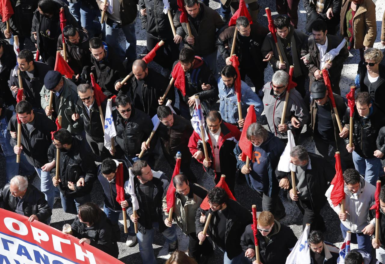 Members of pro-communist union PAME gather during a protest in Athens, Wednesday, Feb. 20, 2013. Unions have launched another general strike against austerity measures in Greece, amid predictions unemployment in the crisis-hit country will reach 30 percent this year. (AP Photo/Dimitri Messinis)