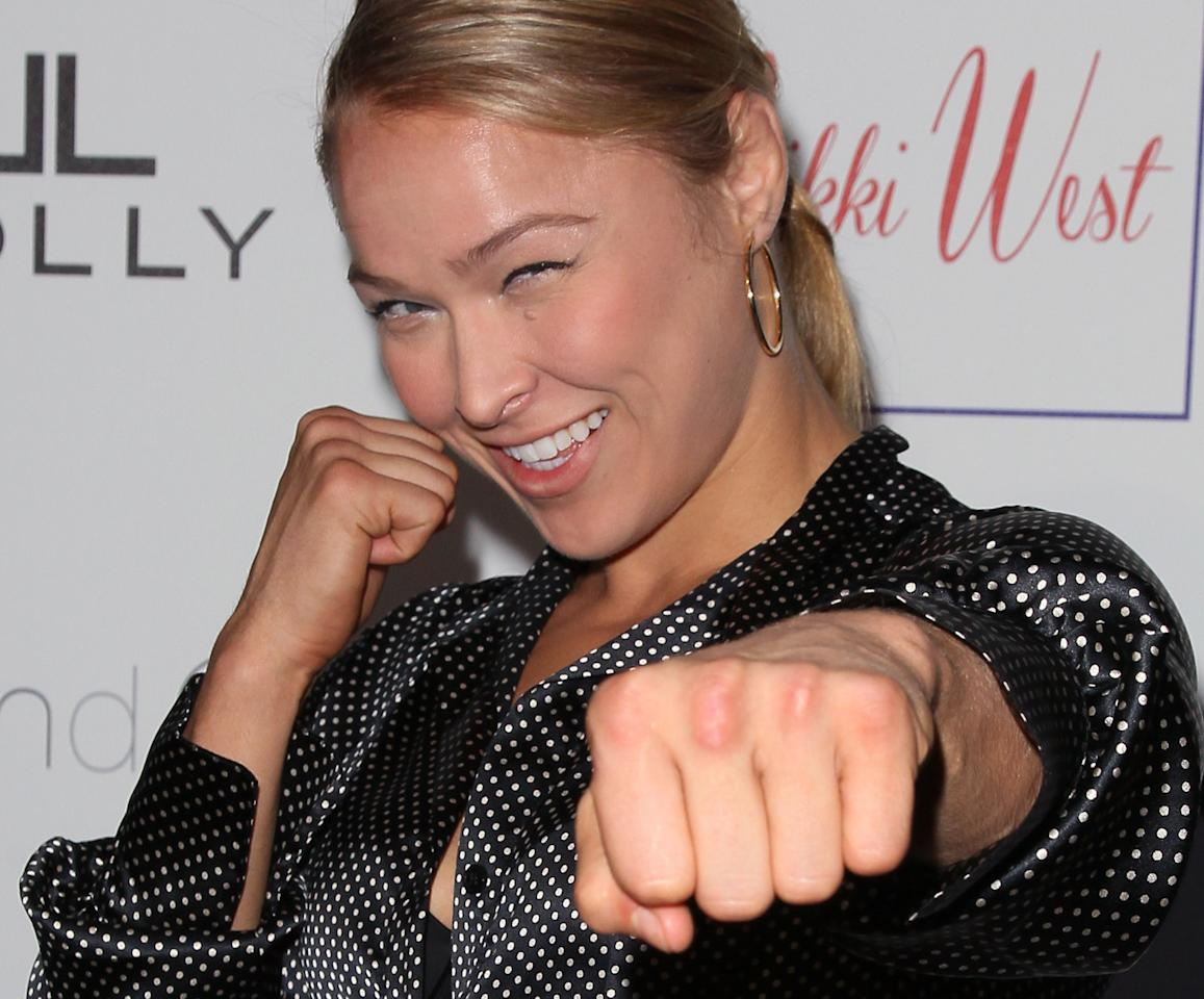"PASADENA, CA - AUGUST 01:  Mixed martial artist Ronda Rousey attends the grand opening and fashion show for Nicole Winnaman's new boutique ""Nikki West"" at Nikki West Boutique on August 1, 2012 in Pasadena, California.  (Photo by David Livingston/Getty Images)"