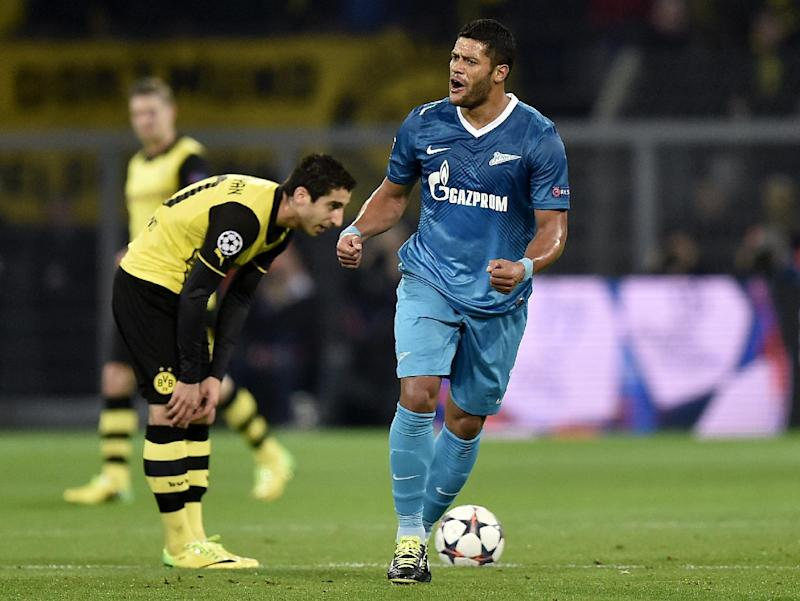 Zenit's Hulk, right, celebrates scoring the opening goal during the UEFA Champions League last 16 second leg soccer match between Borussia Dortmund and FC Zenit in Dortmund, Germany, Wednesday, March 19, 2014. At left is Dortmund's Henrikh Mkhitaryan of Armenia